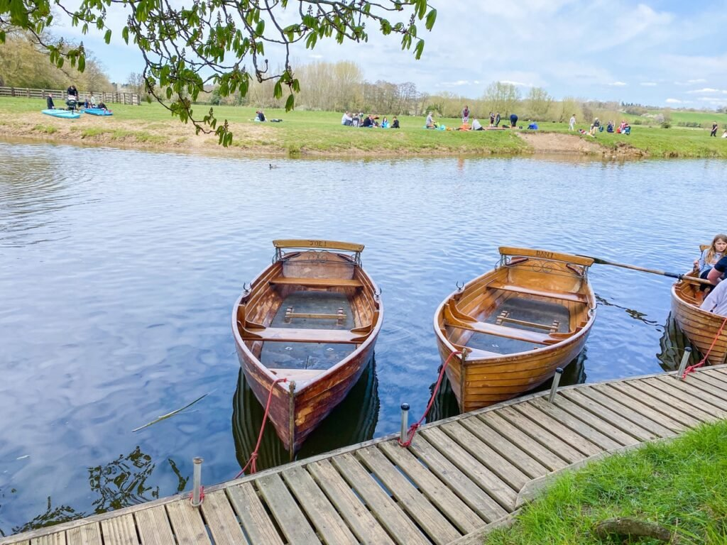 Rowing Boat Hire in Dedham. A row of clinker rowing boats on the water.